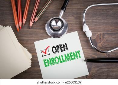 Open Enrollment. Workplace of a doctor. Stethoscope on wooden desk.