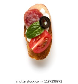 Open faced sandwich canape or crostini isolated on white background closeup. Top view.