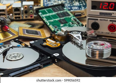 open faulty HDD and SSD in a service laboratory ready for data recovery or repair