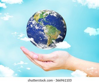 Open female hand with floating  world globe and cloud with light blue sky background, Environment concept, Elements of this image furnished by NASA