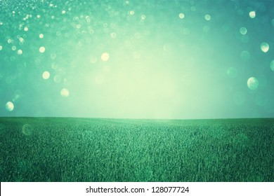 open field view with defocused lights, or fantasy abstract background with glitters, cross process effect
