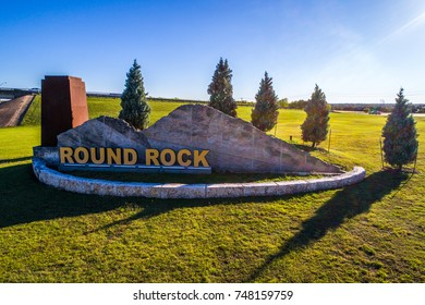 Open field with welcome sign to Round Rock , Texas