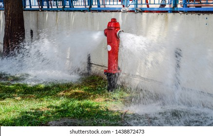 Open fire hydrant, water flows from a fire hydrant