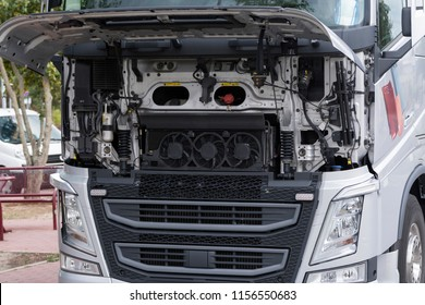 The open flap on a truck allows a view of the radiator and the fans