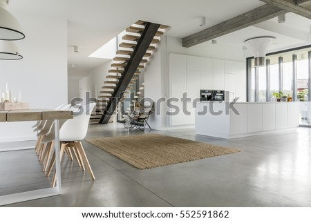 Open Floor Apartment With Staircase Dining Table And Kitchen