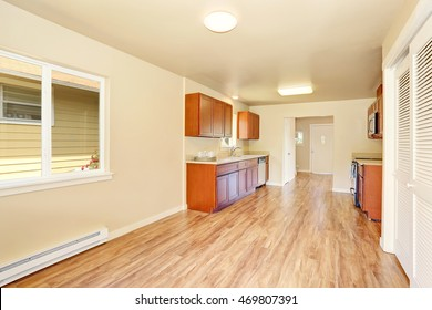 Open floor plan kitchen room interior with wooden cabinets and granite counter top. Northwest, USA