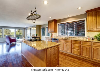 Open floor plan. Kitchen room interior with island and granite counter top. Northwest, USA