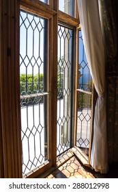Open French window overlooking the sea in the summer