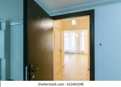 The open front door in renovated apartment in new building