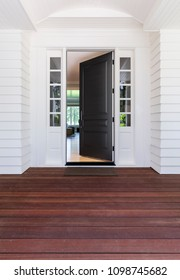 Open front door with wood decking.