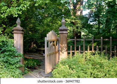 An open garden gate offers an invitation to enter into a shady and secluded area.