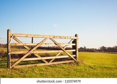An open gate on farmland in England