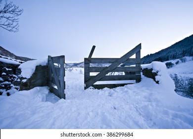 open gate in winter wonderland dusk