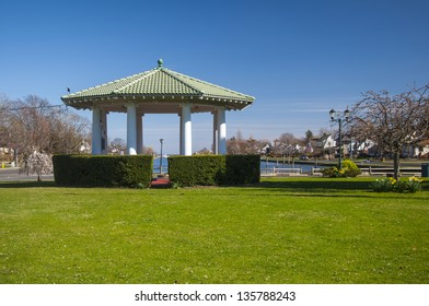 An open gazebo in a waterfront park