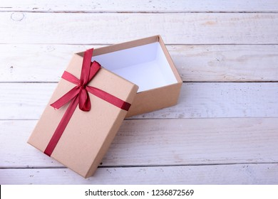 Open Gift boxes with bow on wood background. Christmas Decoration