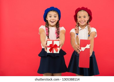 Open gift now. Friendship concept. Birthday present. Shopping and holidays. For my dear friend. Girl giving gift box to friend. Girls friends celebrate holiday. Children formal wear with gift box.