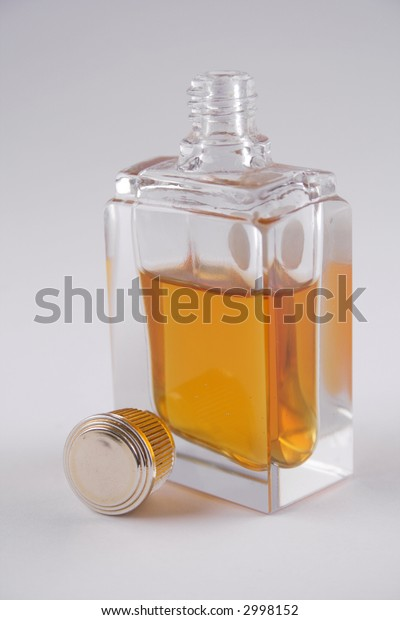 open glass perfume bottle on white background