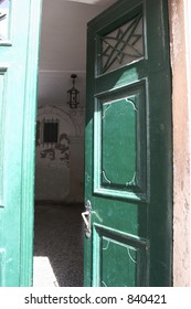 Open green door in Dubrovnik, Croatia.