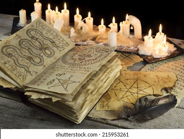 Open Grimoire book with candles and mystic pages