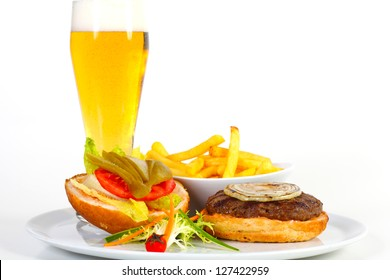 Open hamburger with beer and french fries