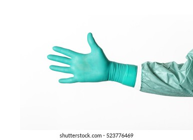 Open hand in a green latex surgical glove on white background