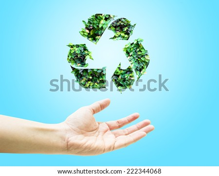 Open hand with green leaf recycle icon on light blue background