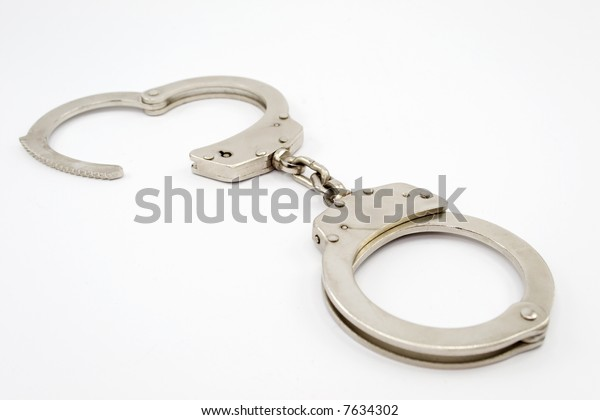 Open handcuff isolated on white