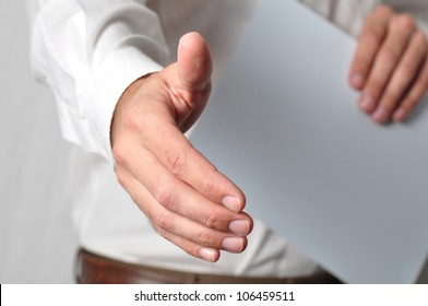 Open handshake and paperwork pose conveying job interview or acceptance