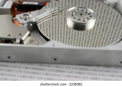 An open Hard disk with binary numbers on the platter  shallow  DOF