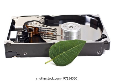 open hard drive unit and one green leaf, isolated over white background