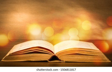 Open Holy bible book on background