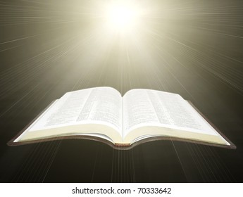 open Holy Bible with rays of light