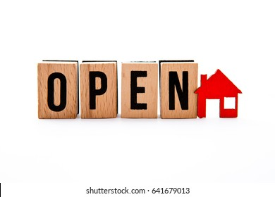 Open House - wooden block letters with red house icon - white background