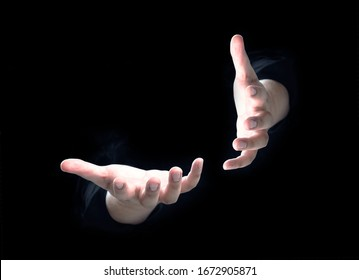 open human hand on dark background for present idea object on copy space with light up