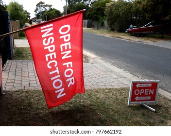 Open for inspection red flag sign in a suburban street