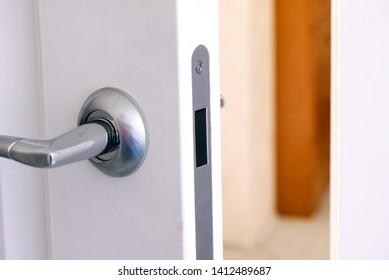 Open interroom door with handle. Close-up.