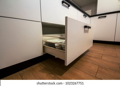 Open kitchen drawer with plates inside, a smart solution for kitchen storage and organizing.