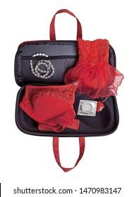 Open ladies handbag with women's facilities and a condom.