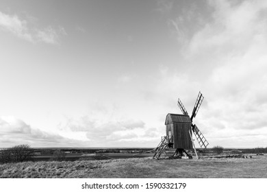 Open landscape with an old windmill in BW at the swedish island Oland, the island of sun and wind