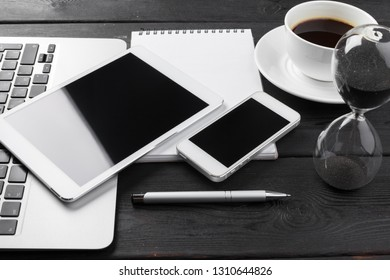 Open laptop with digital tablet and smartphone close up
