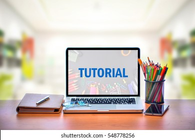 Open laptop with isolated white screen on old wooden desk with text TUTORIAL