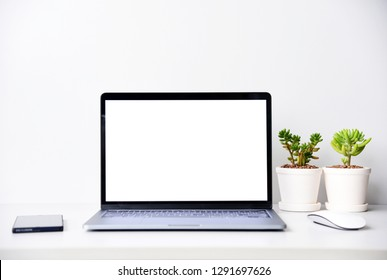 Open the laptop on office desk.front view with copy space