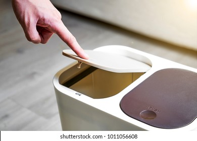 Open the lid of the trash can