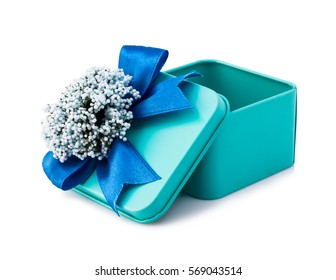 Open light blue gift box with blue ribbon and white flowers isolated on white background. The file includes a clipping path, so it's easy to work.