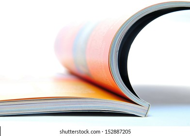 Open magazine with orange colored sites