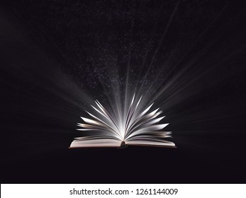 An open magic book, bewitched book glows in the darkness, magic light. Education. Dreamy image of a fairytale