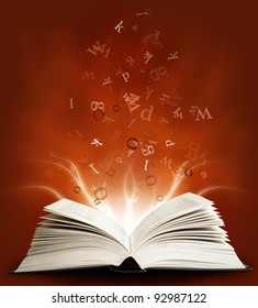 Open magic book with the letters on a red background and lights