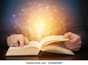 open magic book with shining light sparkles