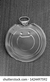 Open metal can silver aluminium lid on flat surface