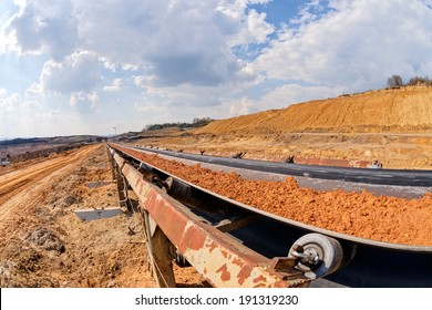 open miming pit with heavy machinery